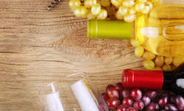 Bottles of red and white wine on old wood Royalty Free Stock Photography