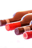 Bottles of red Wine Isolated. Four bottles of red wine isolated on a white background Royalty Free Stock Image