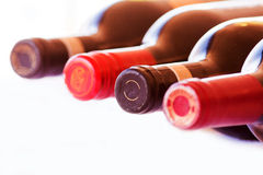 Bottles of red Wine Isolated. Four bottles of red wine isolated on a white background Royalty Free Stock Photos