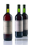 Bottles of red wine  on white Stock Image