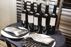 Bottles of red winw on a table. Royalty Free Stock Image