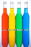 Bottles red yellow green blue. Bottles with red yellow green and blue liquid on mirror Royalty Free Stock Image