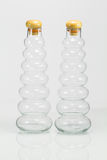 Bottles with reflection on white background Stock Images