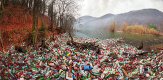 Bottles in the reservoir mountain Royalty Free Stock Photo