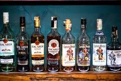 Bottles of rum. BRATISLAVA, SLOVAKIA - CIRCA JUNE 2015: Beer bottles bacardi, havana and captain morgen on the wooden shelf in a bar Royalty Free Stock Images