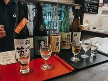 KYOTO, JAPAN, SEPTEMBER 14, 2017:Bottles of Sake are display in restaurant. Sake is a Japanese rice wine made by fermenting rice royalty free stock photos
