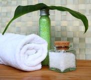 Bottles of sea salt in spa composition Stock Photos