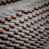 Bottles sealed with wine in storage Royalty Free Stock Photo