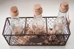 The bottles with seashells. In iron box royalty free stock images