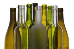 Bottles. Several bottles illuminated backlit and isolated on white background Royalty Free Stock Photography