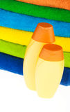Bottles of shampoo and colour terry towels Stock Image