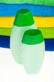 Bottles of shampoo and colour terry towels Stock Photography