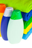Bottles of shampoo and colour terry towels Royalty Free Stock Images