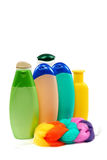 Bottles of shampoo, soap and colored sponge. Royalty Free Stock Image