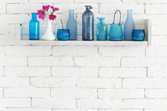 Bottles on a shelf royalty free stock image