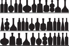 Bottles on shelves Stock Image