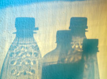 Bottles Silhouette. Detail of multicolored shadows of bottles stock photography