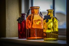 Bottles on the Sill Royalty Free Stock Images
