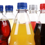 Bottles with soda drinks like cola and orange lemonade Royalty Free Stock Photos