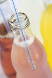Bottles of soda with straw Royalty Free Stock Image