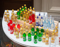 Bottles of soft drink standing on counter Stock Photo