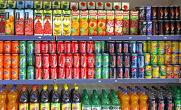 Bottles of soft drinks on a market shelves Stock Photo