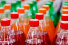 Bottles with soft drinks. Plastic bottles with soft drinks background Royalty Free Stock Image
