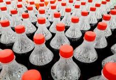 Bottles of soft drinks. Rows of Bottles of soft drinks for background Stock Image