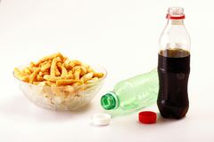 Bottles of softdrinks or soda, and chips Royalty Free Stock Photos