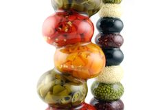 Bottles of spiced Chilies. Bottles of spices in unusual shaped bottles Stock Photography