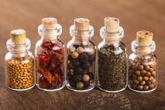 Bottles with spices Royalty Free Stock Images