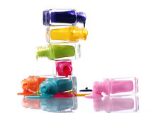 Bottles with spilled nail polish. Over white background Royalty Free Stock Images