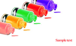 Bottles with spilled nail polish. Over white background Royalty Free Stock Photography