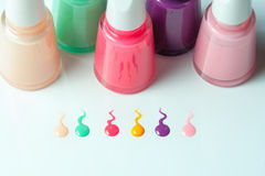 Bottles with spilled nail polish Royalty Free Stock Photography