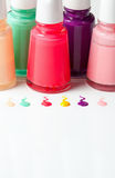 Bottles with spilled nail polish. Over white background Stock Images