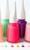 Bottles with spilled nail polish. Over white background Stock Photos