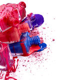 Bottles with spilled nail polish and crushed eye shadow Royalty Free Stock Image