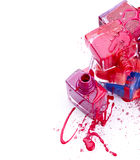 Bottles with spilled nail polish and crushed eye shadow Royalty Free Stock Photo