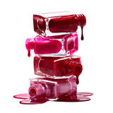 Bottles with spilled nail polish Royalty Free Stock Images