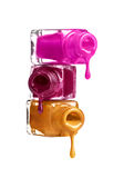 Bottles with spilled nail polish Stock Image