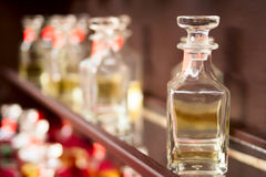 The bottles with spirits on a show-window of shop Stock Photo