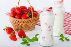Bottles of strawberry yogurt Stock Photo