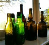 Bottles in the sun stock photo