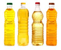 Bottles of sunflower oil isolated on white background. Bottles of sunflower oil isolated on white background Royalty Free Stock Images