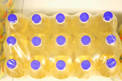 Bottles of sunflower oil with plastic bag Royalty Free Stock Photos