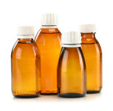 Bottles of syrup medication on white Royalty Free Stock Photos