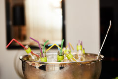 Bottles with tasty drink in ice. Shallow dof Stock Photo