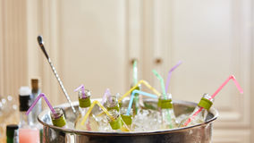 Bottles with tasty drink in ice. Shallow dof Royalty Free Stock Image