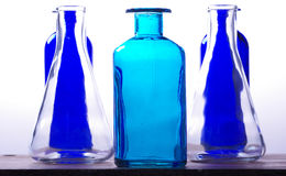 The bottles and their glass trasparency Royalty Free Stock Photography