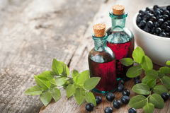 Bottles of tincture or cosmetic product and blueberries Stock Image